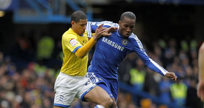 Drogba, back from the Africa Cup of Nations, gets stuck in against Birmingham