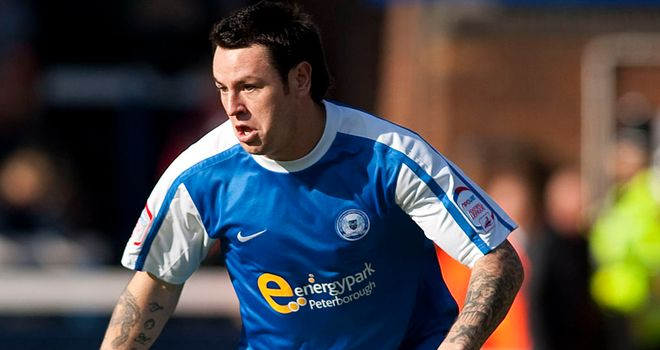 Lee Tomlin: Set Peterborough on their way to win at Molineux