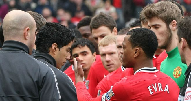 Luis Suarez: Liverpool striker has apologised for not shaking Man Utd defender Patrice Evra's hand