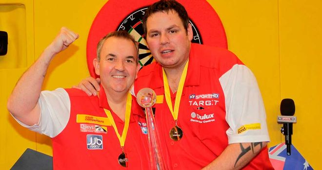 Phil Taylor (L) and Adrian Lewis celebrate 12 months ago