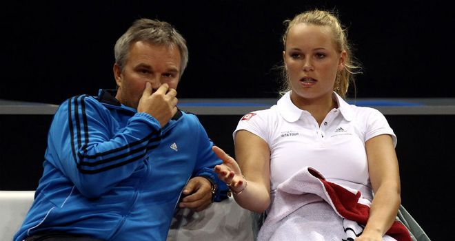 Caroline Wozniacki: Will go back to being coached by her father Piotr (L)