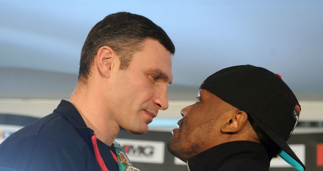 Vitali Klitschko and Dereck Chisora eyeball each other at the pre-fight press conference