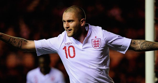 Henri Lansbury: Two from the young Gunner in 4-0 rout of Belgium leaves England one win short of Euro 2013 qualification