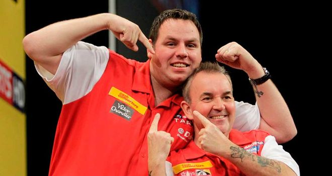 Adrian Lewis and Phil Taylor celebrate their victory