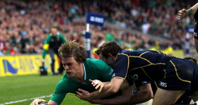Andrew Trimble stretches to score in the corner