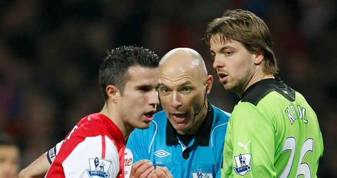 Row: Van Persie and Krul squared up after Arsenal's win against Newcastle