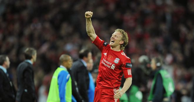 Dirk Kuyt: Liverpool striker celebrating the Carling Cup win over Cardiff on penalties