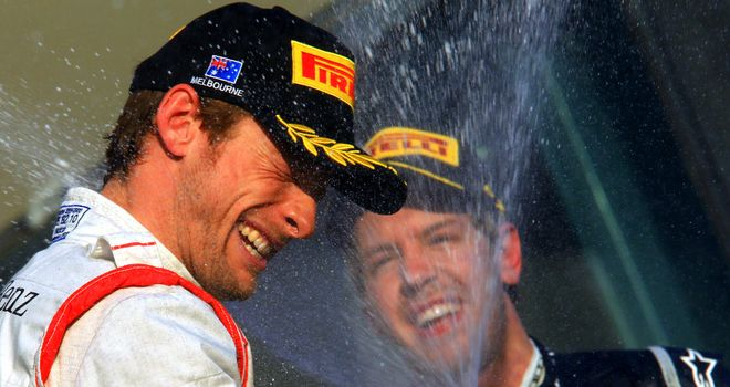 Sebastian Vettel (R) celebrates on the podium in Melbourne with race winner Jenson Button (L)