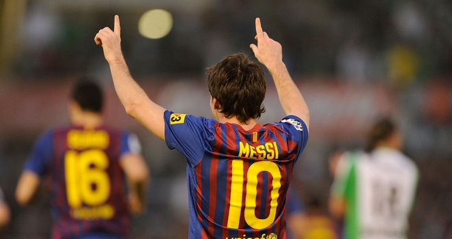 Messi celebrates one of two goals against Santander