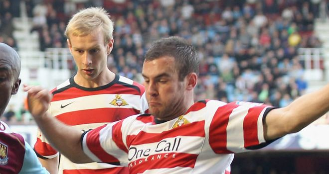 Tommy Spurr: Doncaster Rovers full-back will miss the rest of the season due to a broken hand