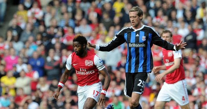Peter Crouch battles Alex Song at the Emirates earlier in the season