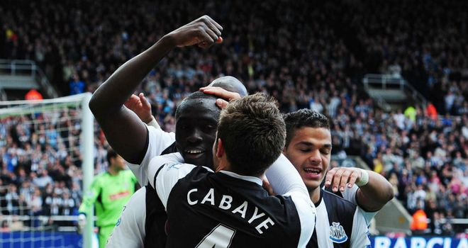 Papiss Cisse celebrates his 11th goal in 10 Premier League games since joining Newcastle