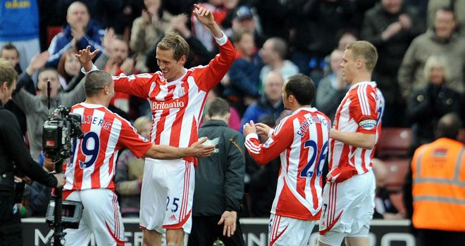 Peter Crouch celebrates his winning goal against Wolves