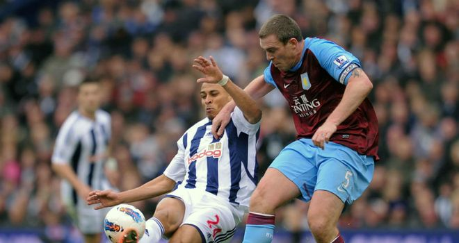 Peter Odemwingie & Richard Dunne: Duo go for the same ball during West Brom¿s clash with Villa