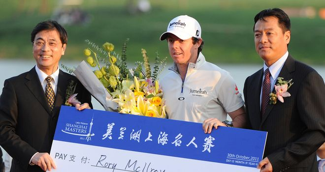 Rory McIlroy: Displaying the huge cheque he won last year in Shanghai