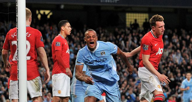 Vincent Kompany celebrates his winning goal for Manchester City