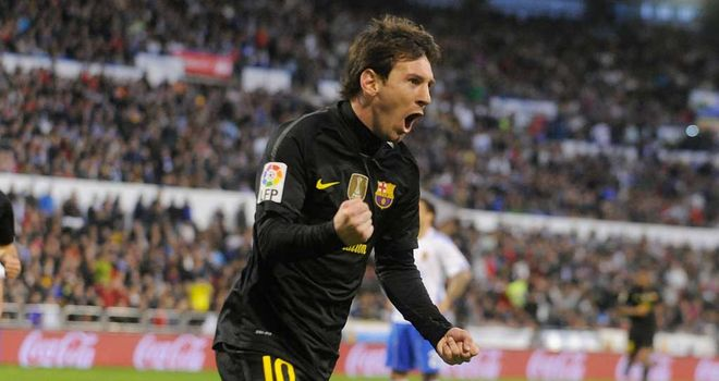 Lionel Messi celebrates his 60th goal of the season in the win over Real Zaragoza
