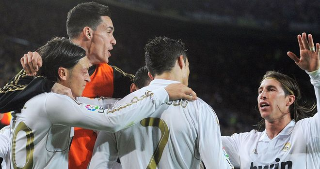 Real Madrid celebrate defeating arch-rivals Barcelona at the Camp Nou