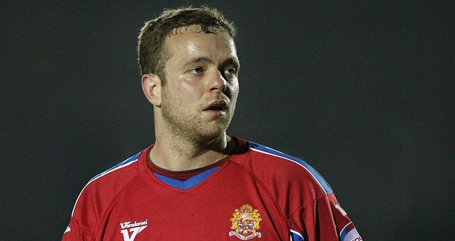 Brian Woodall: Flattered to be linked with a move away from Dagenham