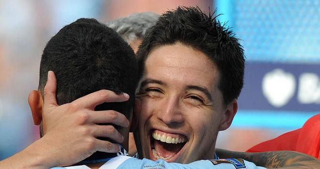 Samir Nasri celebrates winning the title in his first season at Manchester City