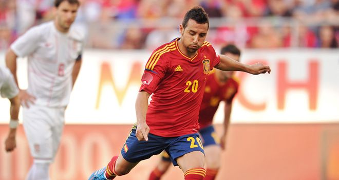 Santi Cazorla fires home Spain's second goal from the penalty spot