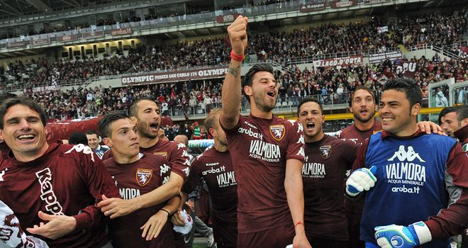 Torino's players celebrate winning promotion to Serie A