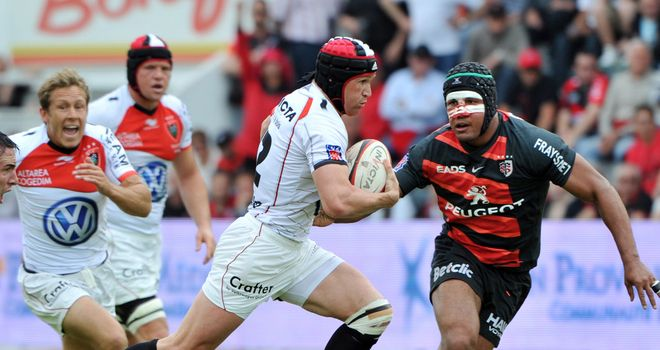 Tough battle: Matt Giteau tries to escape Thierry Dusautoir