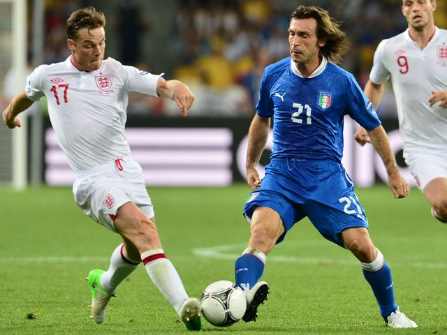 Parker tries to win the ball from Pirlo.