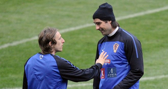 Luka Modric (left) and Vedran Corulka: Defender fears playmaker could leave Spurs this summer