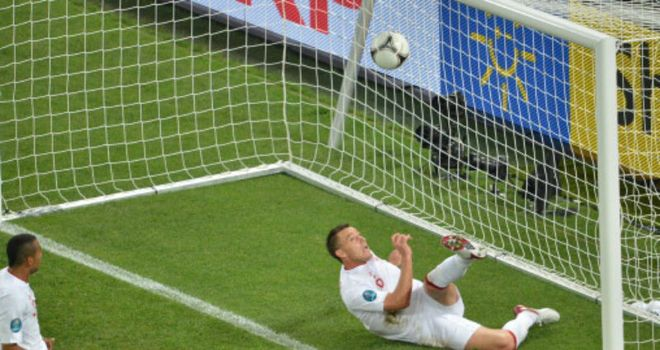 John Terry clears the ball from under his own crossbar against Ukraine