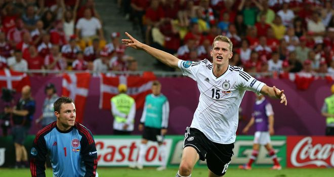 Lars Bender: Celebrates his winner which saw Germany take maximum points