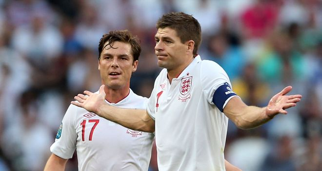 Key duo: Scott Parker and Steven Gerrard put in a hard shift against France on Monday