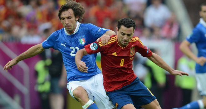 Andrea Pirlo and Xavi will meet in another mouthwatering showdown in the centre of midfield
