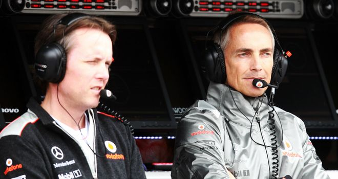 Martin Whitmarsh watches practice from the pitwall with Sam Michael