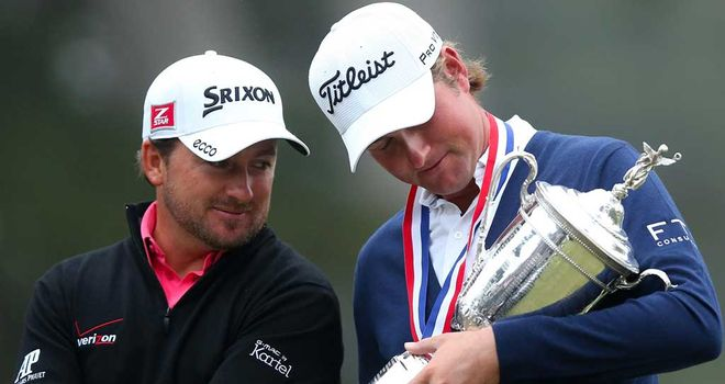 Graeme McDowell: Looks on at Simpson's trophy