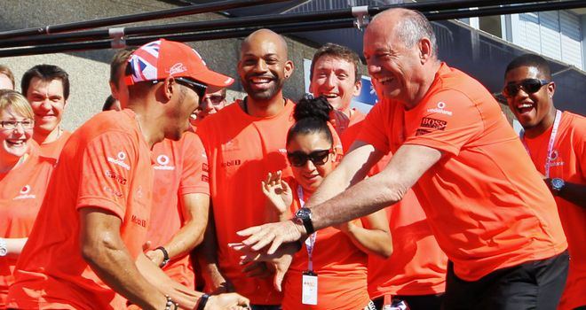 Lewis Hamilton and Ron Dennis celebrate in Montreal