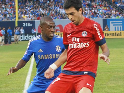 Javier Pastore battles with Gael Kakuta
