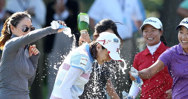 Choi: Sprayed in victory champagne on the 18th green