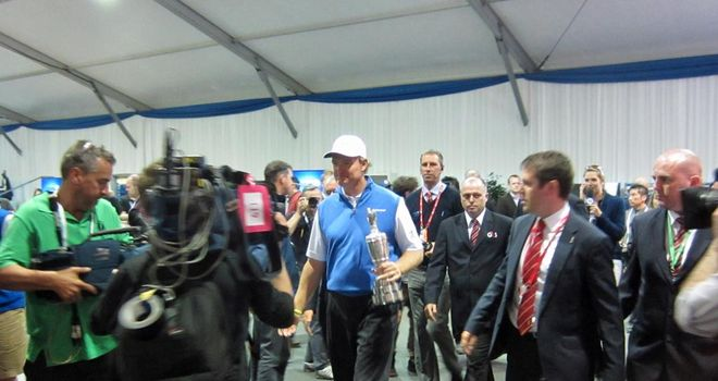 Ernie Els walks into the media centre with the Claret Jug
