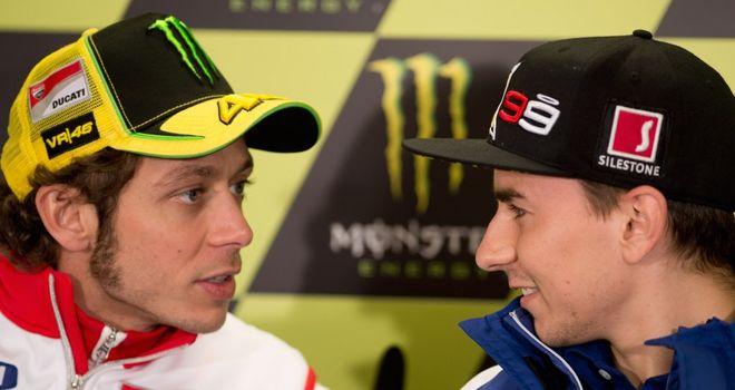 Valentino Rossi (l) and Jorge Lorenzo (r)