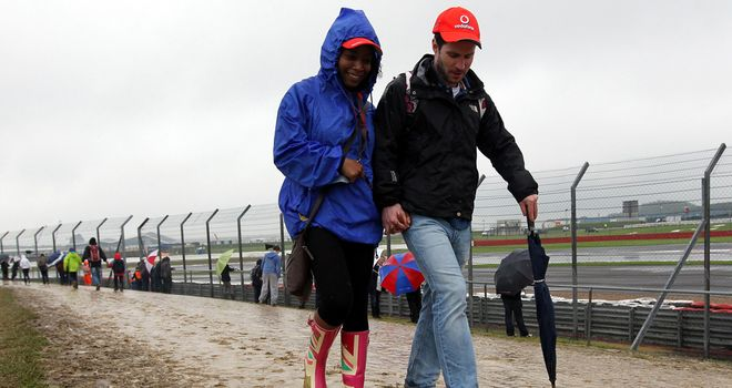 Muddy: Silverstone's car parks were reduced to quagmires by the rain