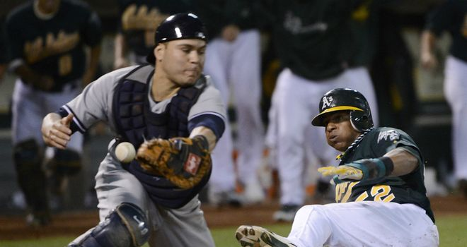 Winning run: Oakland's Yoenis Cespedes slides into home from Brandon Moss' RBI single