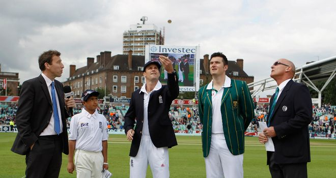 Toss: England captain Andrew Strauss flips the coin