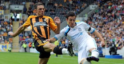 Danny East (left) in action for Hull City