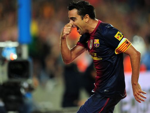 Xavi: Signs an extension to his Barcelona deal