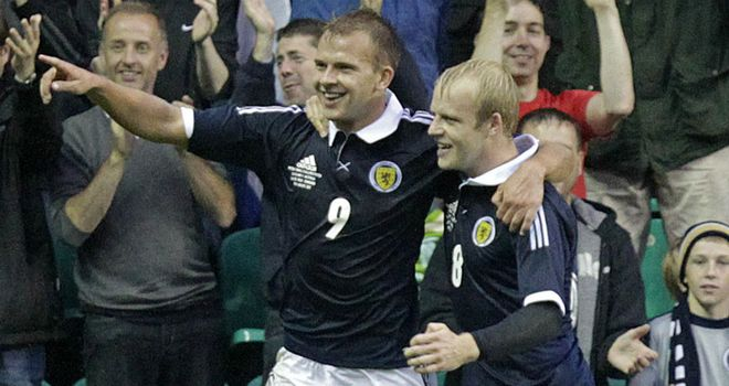 Jordan Rhodes: Celebrates scoring against Australia on his first Scotland start with Steven Naismith
