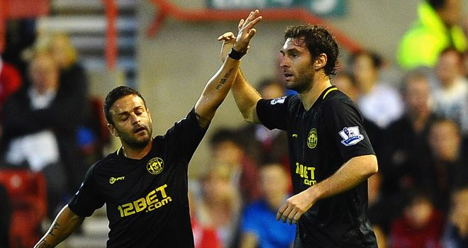 Mauro Boselli bagged a brace as Wigan dumped West Ham out of the Capital One Cup