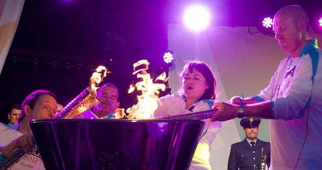 Torchbearers light the Paralympic Flame in Stoke Mandeville