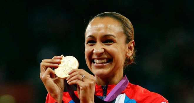 Jessica Ennis celebrates after receiving her gold medal at the Olympic Stadium
