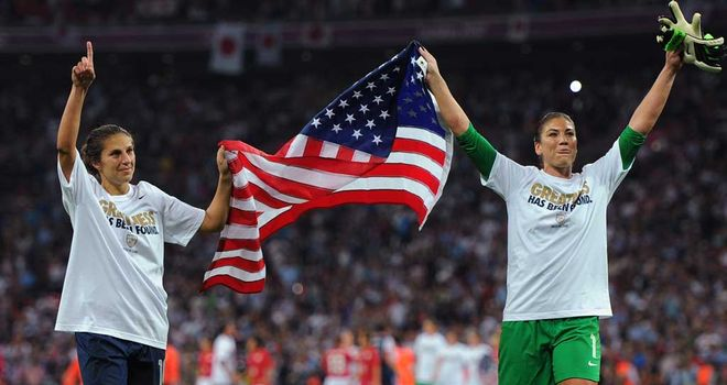 Carli Lloyd and Hope Solo celebrate after the USA's 2-1 win over Japan at Wembley